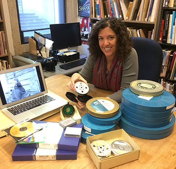 Woman with film reels